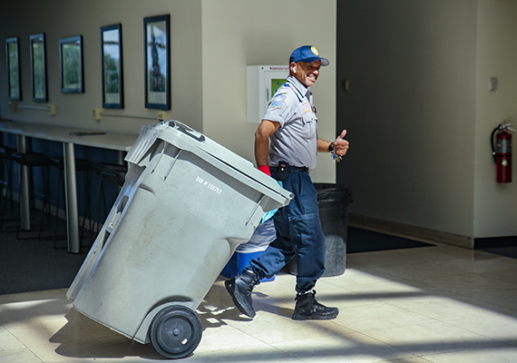 Man with shred bin